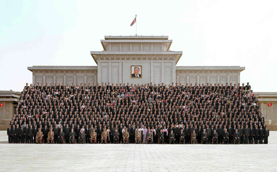 In this photo released by Korean Central News Agency via Korean News Service on September 30, North Korean leader Kim Jong-Il (C, front row) and the Workers' Party of Korea executives and delegates pose for photographs at the Kumsusan Memorial Palace in Pyongyang, North Korea. North Korean leader Kim was re-appointed as the party's secretary general and has made a military general of Kim Jong-Un, believed to be his third son. Photo: Handout, Getty Images / 2010 Korean News Service