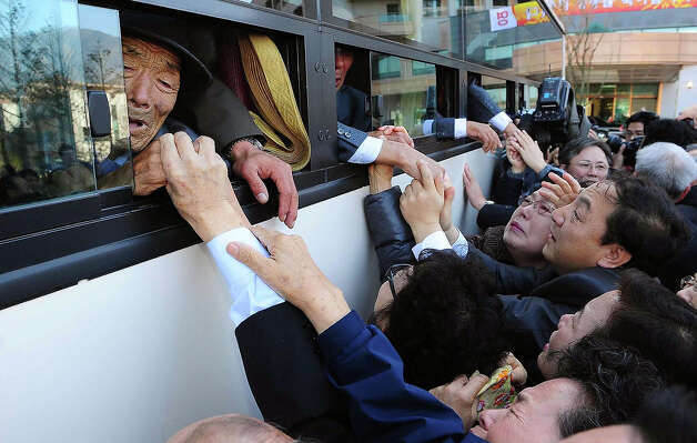 North Koreans in a bus bid farewell to their South Korean relatives before they return to their home after a family reunion after being separated for 60 years following the North Korean War on November 1, 2010 in Mount Kumgang, North Korea. Red Cross officials from the two Koreas exchanged lists of families to be reunited, 100 names each, at a checkpoint in the border town of Kaesong in North Korea. Photo: Pool, Getty Images / 2010 Getty Images