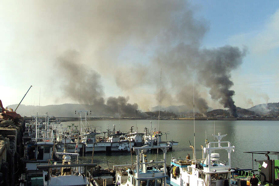 In this image provided by a local resident, Smoke rises from South Korea's Yeonpyeong island near the border against North Korea on November 23, 2010 in Seoul, South Korea. Dozens of artillery shells fired by North Korea hit the South Korean Island of Yeonpyeong reportedly causing injuries and prompting return fire from South Korean forces. The incident comes amid tensions over North Korea's nuclear program and the announcement of North Korean leader Kim Jong Il's youngest son as his successor. Photo: Getty Images / 2010 Getty Images