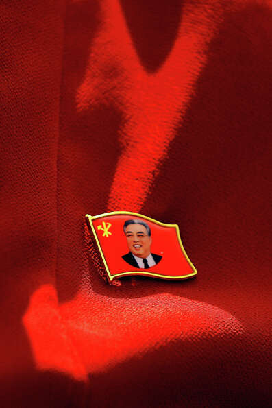 A pin depicting Kim Il Sung, founder of North Korea is attached to the skirt of a teacher in a prima