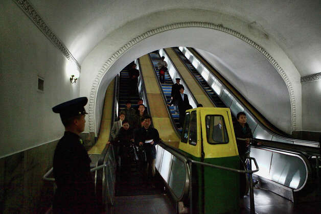 Commuters move by escalator at Puhung Subway station situated more than 100M below the surface, it is also an atomic shelter, on April 2, 2011 in Pyongyang, North Korea. Pyongyang is the capital city of North Korea and the population is about 2,500,000. Photo: Feng Li, Getty Images / 2011 Getty Images