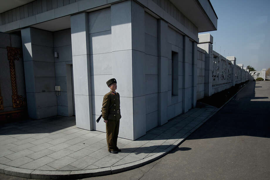 A soldier stands guard outside the Kim-Il-Sung Mausoleum at the Kumusan Memorial Palace on April 3, 2011 in Pyongyang, North Korea. Pyongyang is the capital city of North Korea and the population is about 2,500,000. Photo: Feng Li, Getty Images / 2011 Getty Images