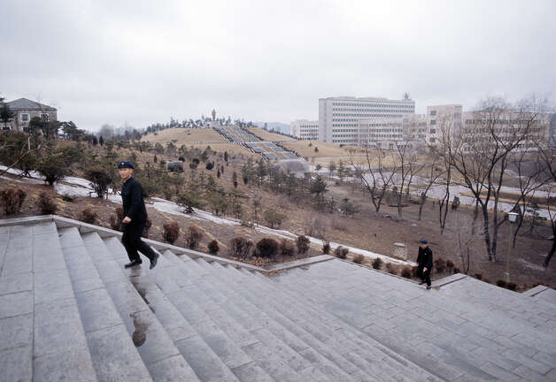 Two men walking up a flight of steps, North Korea, February 1973. Photo: John Bulmer, Getty Images / 2011 Getty Images