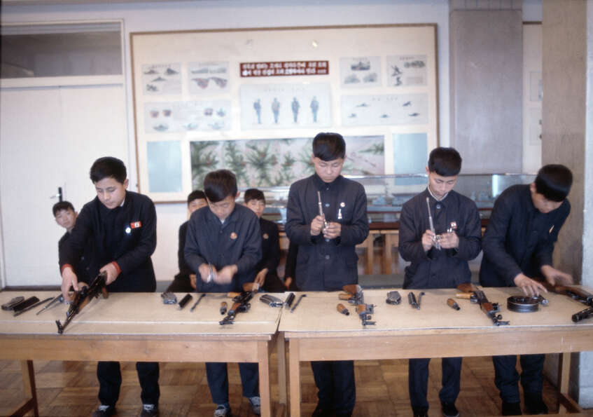 A group of boys assembling assault rifles, North Korea, February 1973.