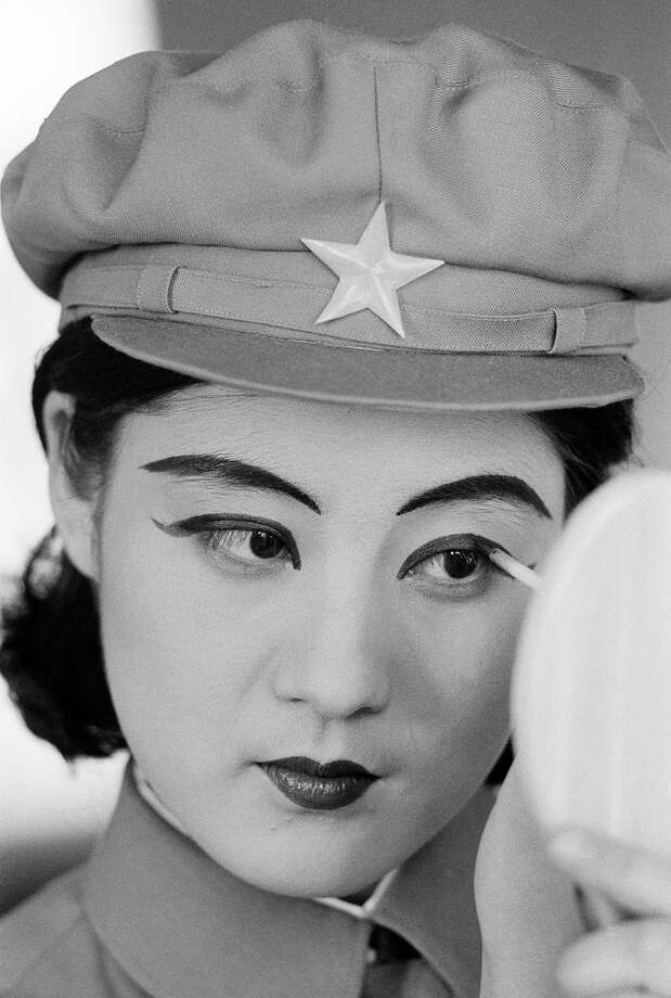 A young woman in uniform applying eye-liner, North Korea, February 1973. Photo: John Bulmer, Getty Images / 2011 Getty Images