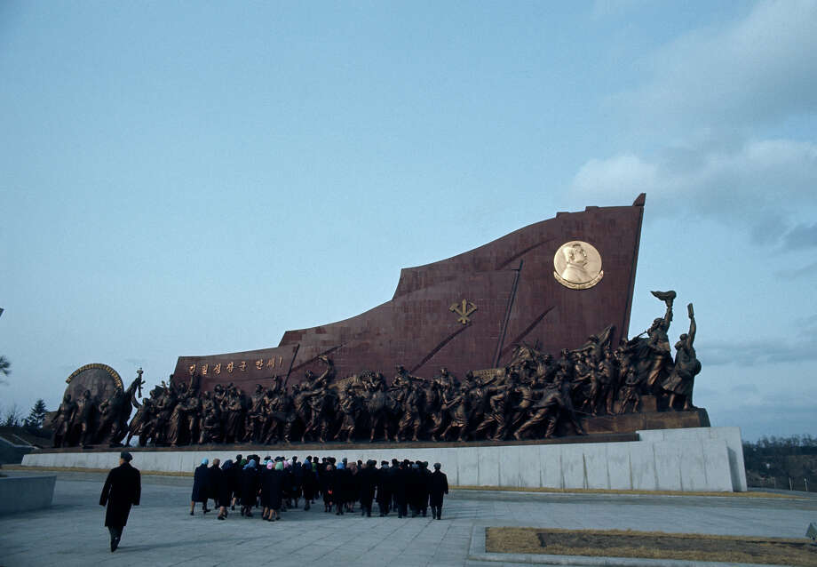 Visitors at the Mansudae Grand Monument, which depicts the North Korean revolutionary struggle, Pyongyang, North Korea, February 1973. Photo: John Bulmer, Getty Images / 2011 Getty Images
