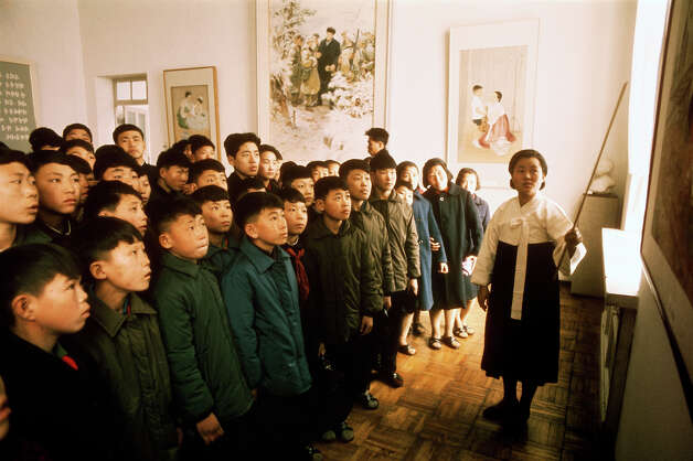 A guide shows a group of schoolchildren round a museum, North Korea, February 1973. Photo: John Bulmer, Getty Images / 2011 Getty Images