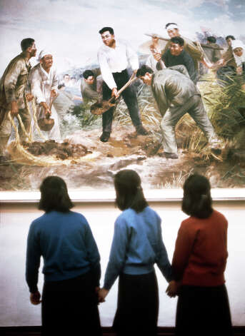 Three teenage girls viewing a painting in a museum in North Korea, February 1973. Photo: John Bulmer, Getty Images / 2011 Getty Images