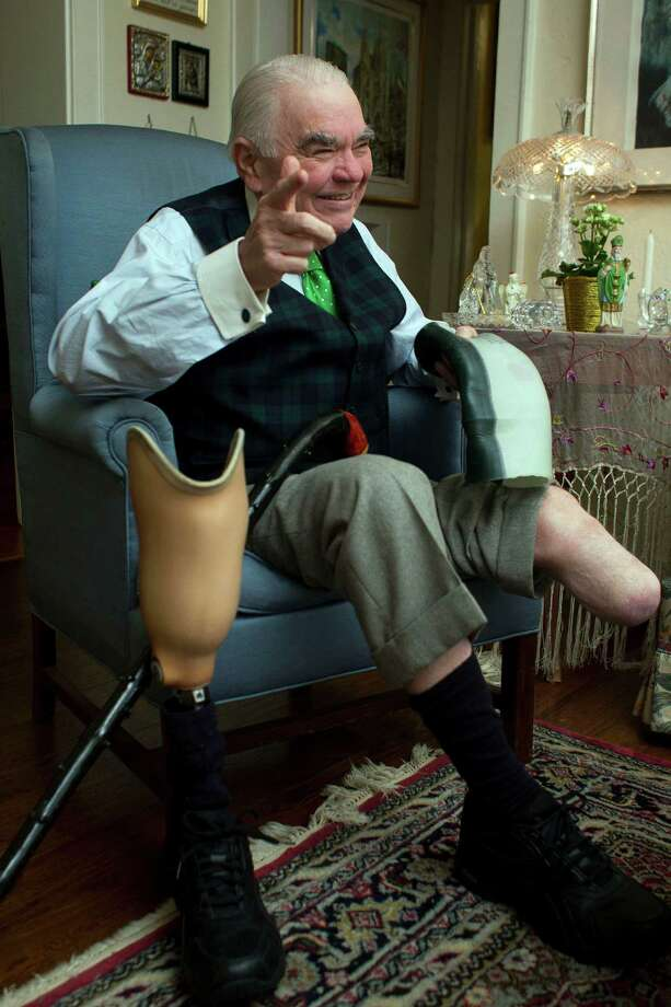 Tom Horan, 68, shows how he puts on his prosthetic leg after he had a partial amputation in 2011 due to complications of diabetes. Photo: Johnny Hanson, Houston Chronicle / © 2013  Houston Chronicle