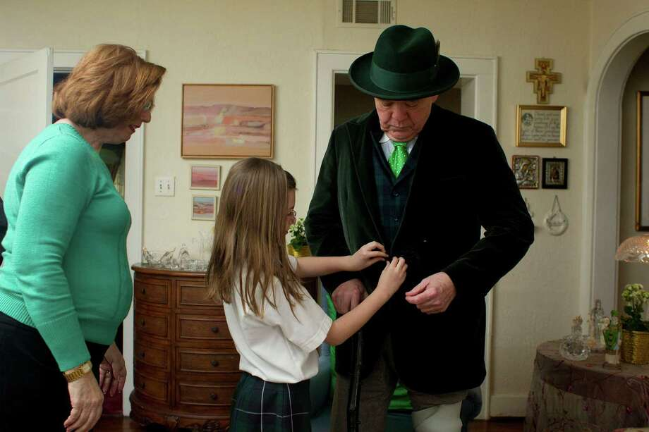 Next to his wife Jeani, 67, granddaughter, Gabriella, 9, Tom Horan, gets his attire ready.  Photo: Johnny Hanson, Houston Chronicle / © 2013  Houston Chronicle