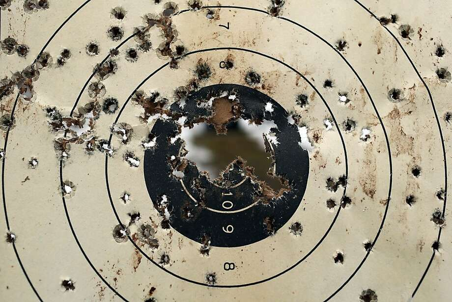A shooitng target is full of bullet holes at a class taught by King 33 Training at a shooting range on February 24, 2013 in Wallingford, Connecticut. King 33 Training, a company that trains and educates individuals on the safe and proper use of guns and other uses of protective force, offers classes to marksmen of all levels. The Connecticut company offers training for clients interested in maintaining a safe environment for themselves, their families, and those around them. Connecticut, home to a number of gun manufactures including Colt Defense, is a state with conflicting views on guns and gun ownership. Currently the state has some of the strictest gun control laws in the nation and its current governor Daniel Malloy is pushing for tougher measures following the shootings at the Sandy Hook School. Photo: Spencer Platt, Getty Images