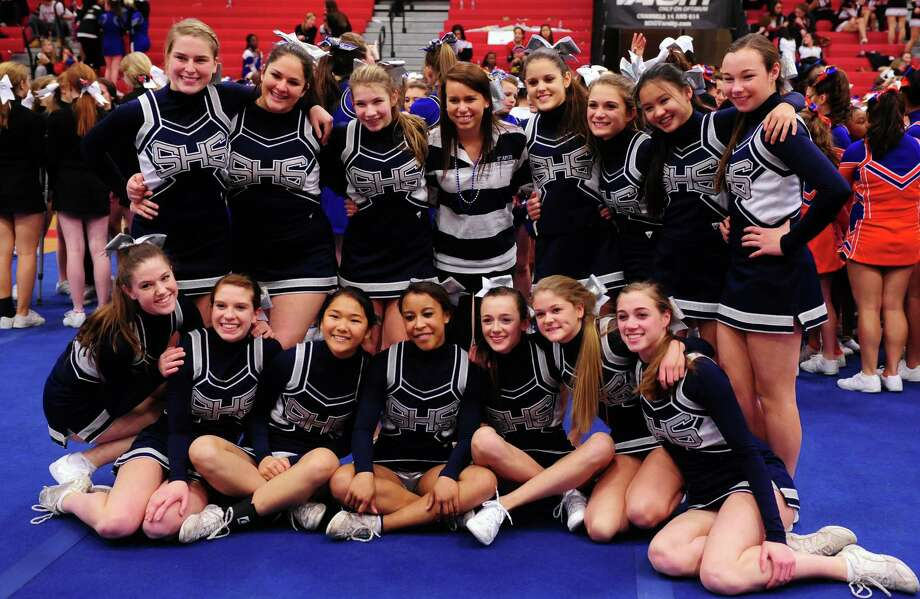 The Staples High School cheerleaders, seen here at the FCIAC championships last month, will stage their 16th annual Varsity Vogue Fashion Show and Auction Friday evening, March 15, at Mitchells, the downtown clothing store. Photo: Autumn Driscoll / Connecticut Post