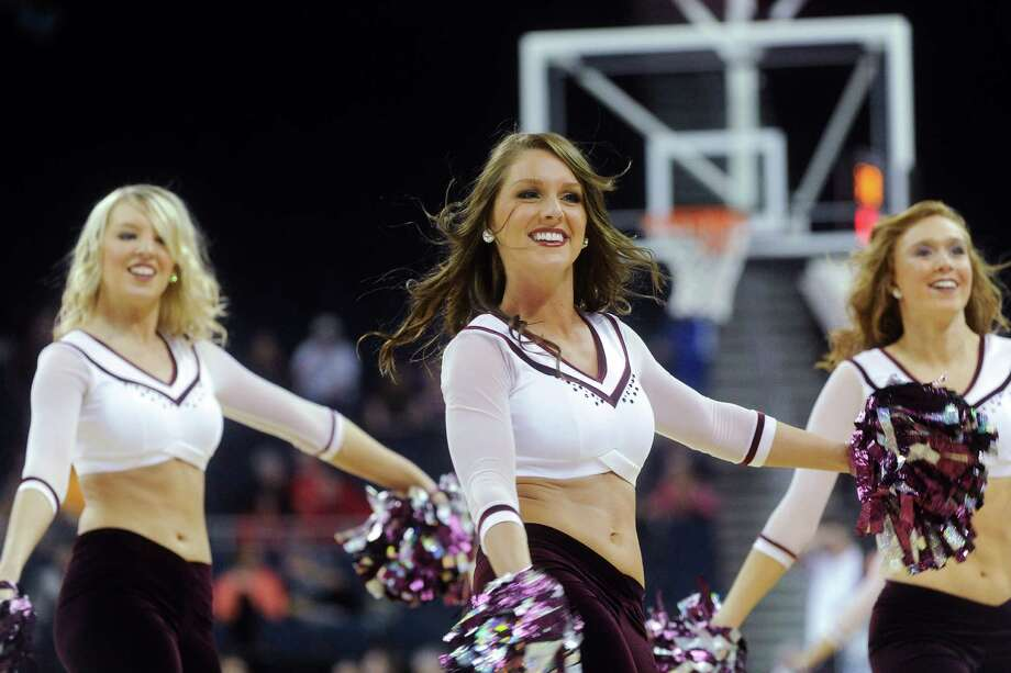 Texas A&M cheerleaders are shown performing against Kentucky during the second half of their NCAA college basketball game in the finals of the Southeastern Conference tournament, Sunday, March 10, 2013, in Duluth, Ga. Texas A&M won 75-67. (AP Photo/John Amis) Photo: John Amis, Associated Press / FR69715 AP