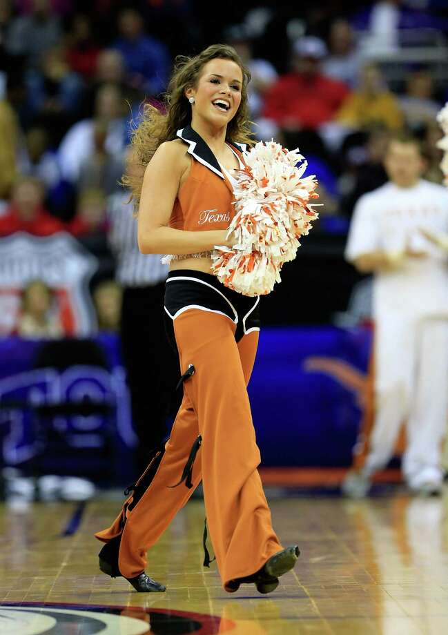 Texas Longhorns cheerleaders perform during the first round of the 2013 Big 12 Men's Basketball Championship at Sprint Center on March 13, 2013 in Kansas City, Missouri. Photo: Jamie Squire, Getty Images / 2013 Getty Images