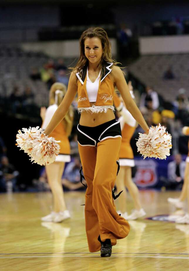 A member of the Texas cheerleaders performs during an NCAA college basketball game against Kansas State in the Big 12 women's tournament Friday, March 8, 2013, in Dallas. Kansas State won 51-49. (AP Photo/Tony Gutierrez) Photo: Tony Gutierrez, Associated Press / AP