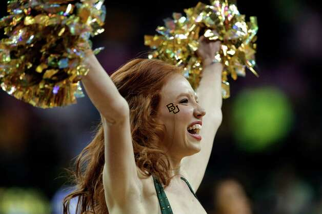 A member of the Baylor cheerleaders performs in the second half of an NCAA college basketball game against TCU Saturday, Feb. 16, 2013, in Waco, Texas. Baylor won 78-45. (AP Photo/Tony Gutierrez) Photo: Tony Gutierrez, Associated Press / AP