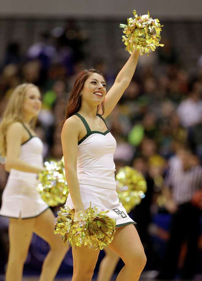 A member of the Baylor  cheerleaders performs during an NCAA college basketball game against Oklahoma State in the Big 12 women's tournament Sunday, March 10, 2013, in Dallas. Baylor won 77-69. (AP Photo/Tony Gutierrez) Photo: Tony Gutierrez, Associated Press / AP