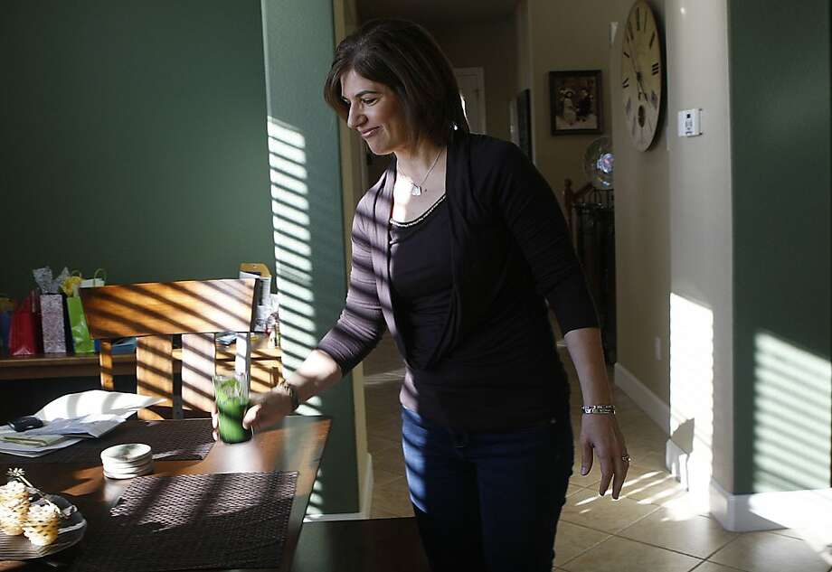 Denise Pangelinan, who had survived an aggressive form of breast cancer,having a vegeatable and fruit smoothie at home in San Ramon, Calif., on Friday, February 22, 2013.   For 16 months she had taken a new breast cancer drug developed by South San FranciscoÕs Genentech and is among the first in a new class of therapies designed to target certain cancer cells and deliver chemotherapy directly into the cell.  The drug was approved today. Photo: Liz Hafalia, The Chronicle