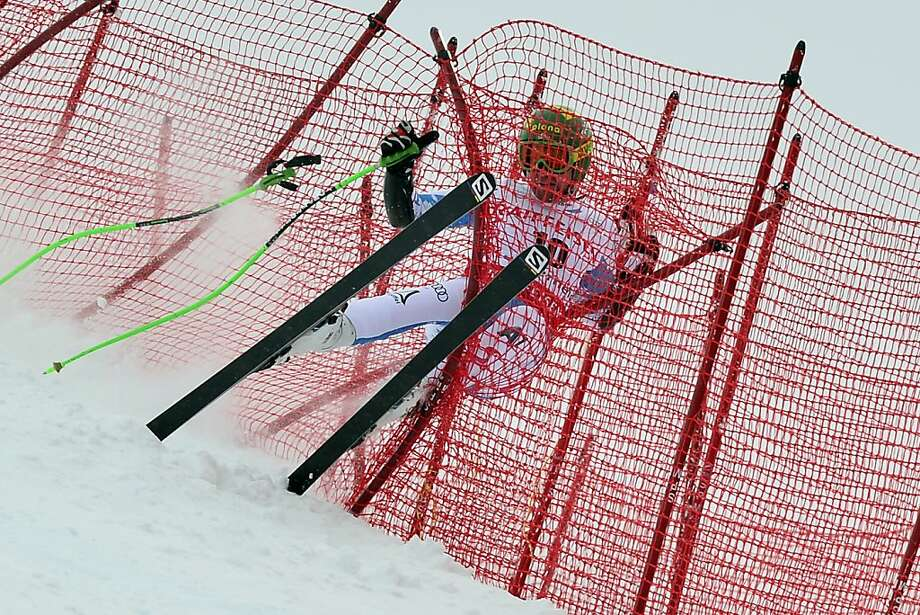 It's a cruel Kroell world: Austria's Klaus Kroell crashes into the barrier nets during the Super G at the World Cup finals in Lenzerheide, Switzerland. Photo: Fabrice Coffrini, AFP/Getty Images