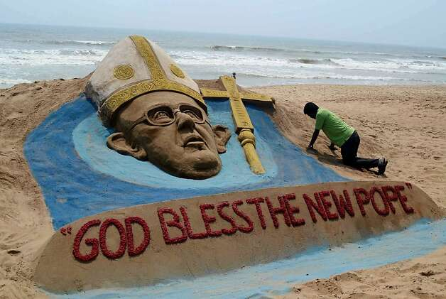 The Shores of the Fisherman: Artist Sudersan Pattnaik works on a sand sculpture of Pope Francis in Puri, India, a day after the cardinals elected the new pontiff. Photo: Asit Kumar, AFP/Getty Images