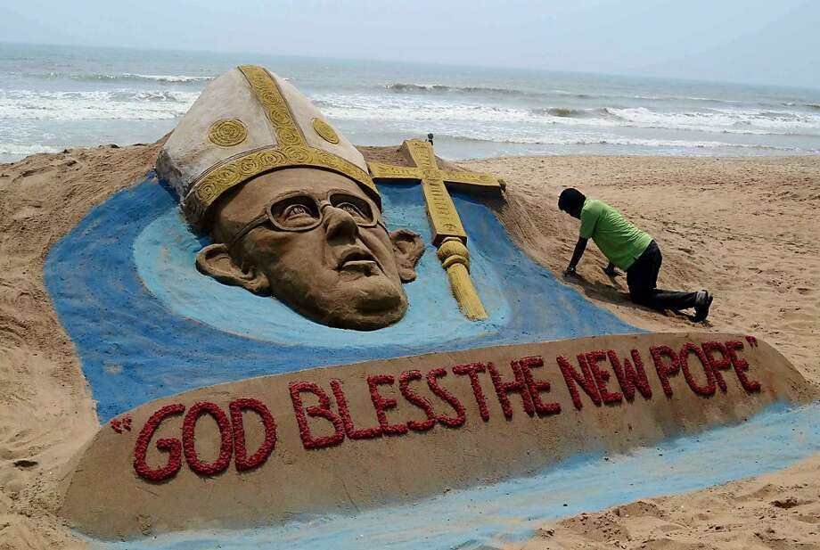 The Shores of the Fisherman:Artist Sudersan Pattnaik works on a sand sculpture of Pope Francis in Puri, India, a day after the cardinals elected the new pontiff. Photo: Asit Kumar, AFP/Getty Images