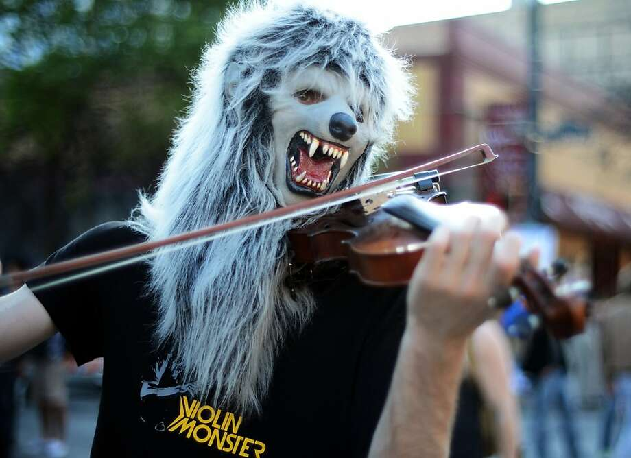 'Well, I saw Lon Chaney walkin' with the queen, doin' the werewolves of Austin': A fiddle player performs at the SXSW Music, Film + Interactive Festival in the Texas capital.  Photo: Michael Buckner, Getty Images For SXSW