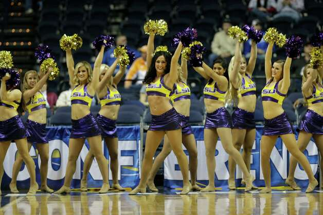LSU  cheerleaders perform during the first half of an NCAA college basketball game after the game at the Southeastern Conference tournament, Thursday, March 14, 2013, in Nashville, Tenn. (AP Photo/Dave Martin) Photo: Dave Martin, Associated Press / AP