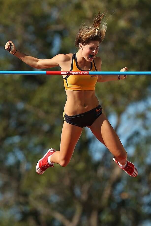 I did it! Nina Kennedy of Western Australia celebrates in mid-air after clearing 4.25 meters in the pole vault at the Australian Junior Championships in Perth. Photo: Paul Kane, Getty Images