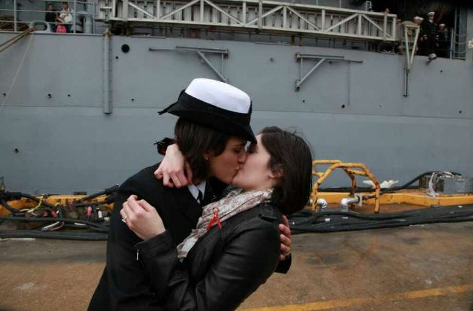 "First same-sex kiss after getting off a Navy ship ... Here's the original caption: ""Petty Officer 2nd Class Marissa Gaeta, left, kisses her girlfriend of two years, Petty Officer 3rd Class Citlalic Snell at Joint Expeditionary Base Little Creek in Virginia Beach, Va., on Wednesday after Gaeta's ship returned from 80 days at sea. It ís a time-honored tradition at Navy homecomings - one lucky sailor is chosen to be first off the ship for the long-awaited kiss with a loved one. On Wednesday, for the first time, the happily reunited couple was gay."" Photo: Multiple"