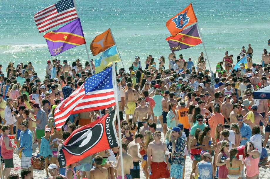 Thousands of spring breakers from around the southeast converge on the beach near the Whale's Tail Restaurant in South Walton County, Florida on Wednesday, March 13, 2013. As college spring breakers make their annual pilgrimage to beaches along the northwest Florida Gulf Coast, local law enforcement personnel are making regular sweeps looking for underage drinkers and managing unurly behavior. Photo: DEVON RAVINE, Associated Press / NORTHWEST FLORIDA DAILY NEWS