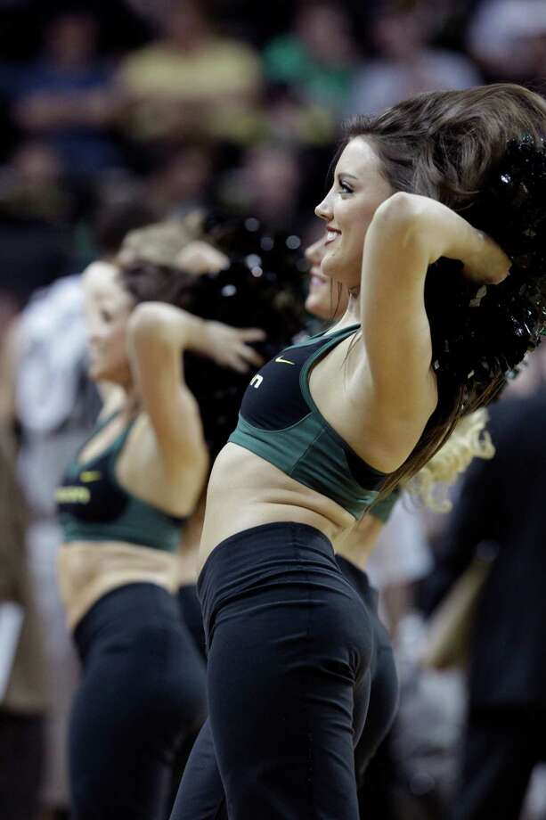 Oregon cheerleaders are shown during the second half of an NCAA college basketball game against California in Eugene, Ore., Thursday, Feb. 21, 2013. (AP Photo/Don Ryan) Photo: Don Ryan, Associated Press / AP