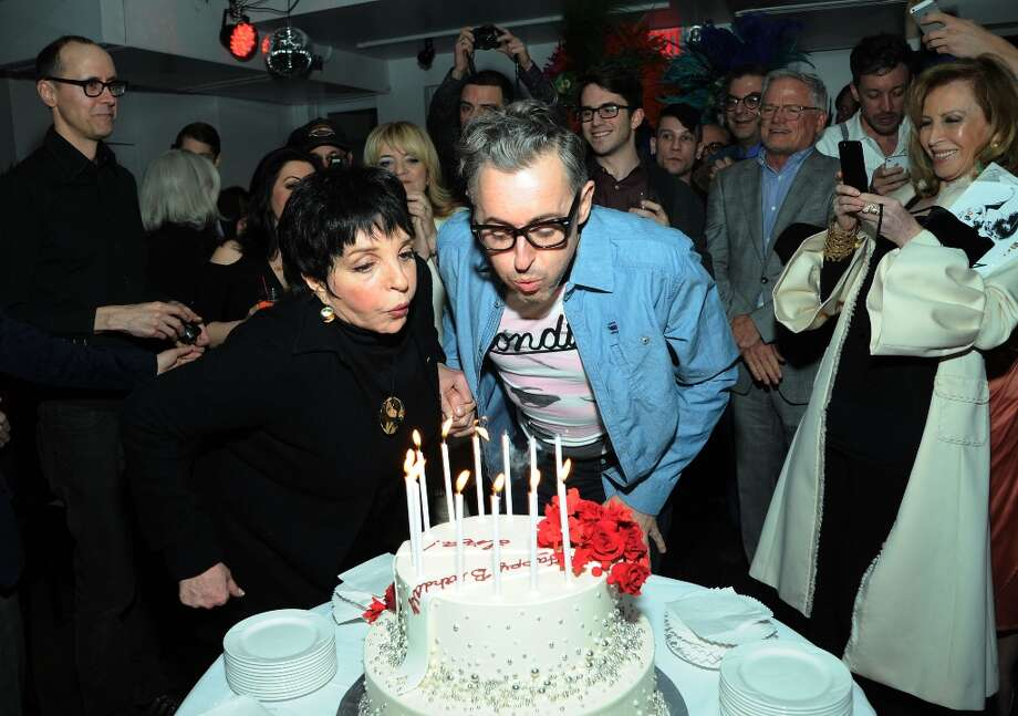 Liza Minnelli and Alan Cumming blow out candles at the Liza Minnelli Birthday Celebration at The Copa on March 13, 2013 in New York City. Photo: Ilya S. Savenok, Getty Images / 2013 Ilya S. Savenok