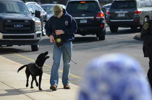New Canaan Police investigate an incident at Saxe Middle School March 14. Police are still on scene. No new details are available, but school will open Friday with a police presence. Staff photo / Megan Spicer Photo: Contributed Photo