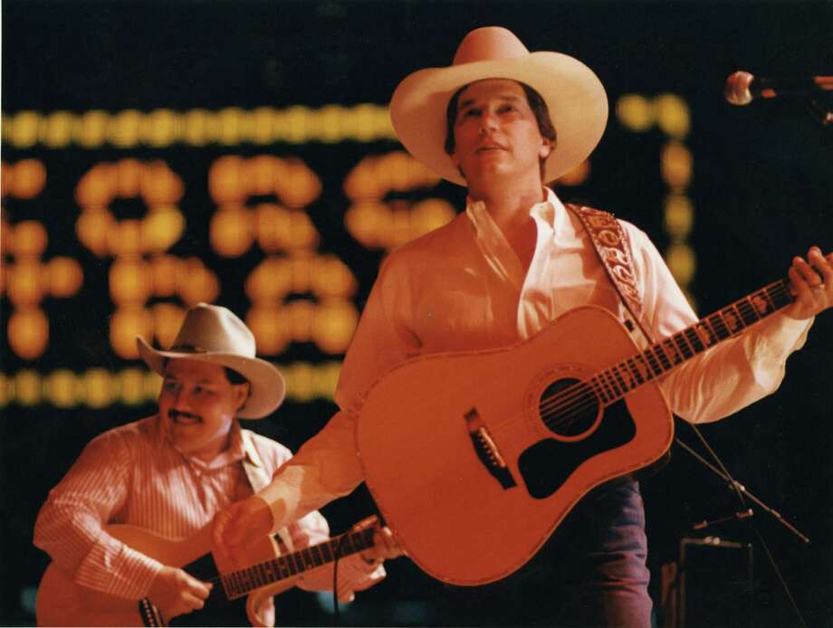 Singer George Strait performs at the Houston Livestock Show & Rodeo in the Houston Astrodome, Feb. 25, 1987. Photo: Steve Ueckert, Houston Chronicle / Houston Chronicle