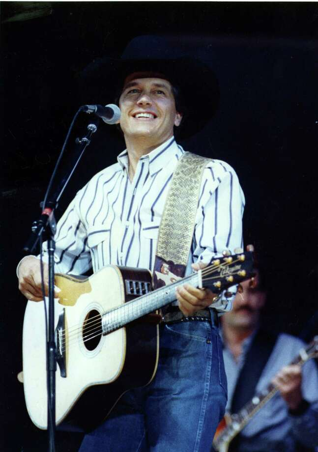 George Strait performs at the 1990 Houston Livestock Show & Rodeo in the Houston Astrodome. Photo: Manuel M. Chavez, Houston Chronicle / Houston Post files