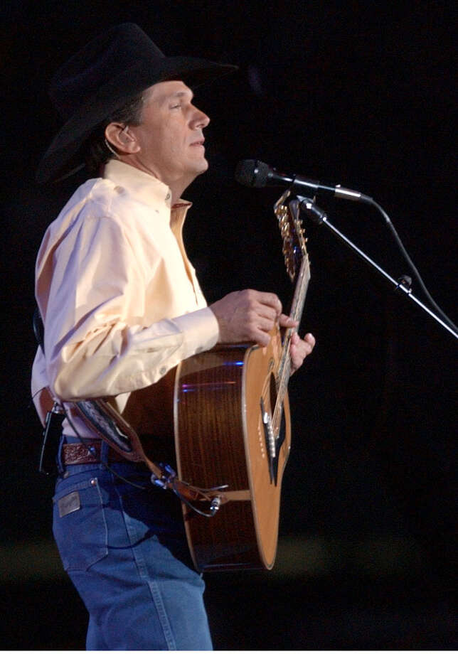 George Strait performs during the last Rodeo concert, at the Astrodome in 2002. Photo: Karen Warren, Houston Chronicle / Houston Chronicle