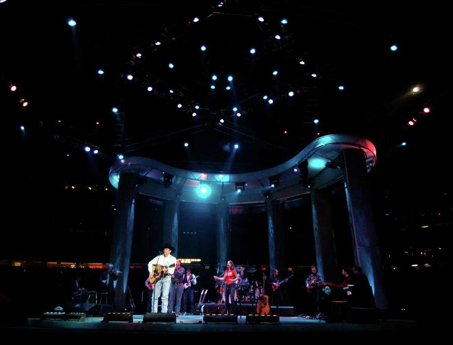 George Strait performs on the second night of the 2004 Houston Livestock Show and Rodeo at Reliant Park. Photo: Karl Stolleis, Houston Chronicle / Houston Chronicle