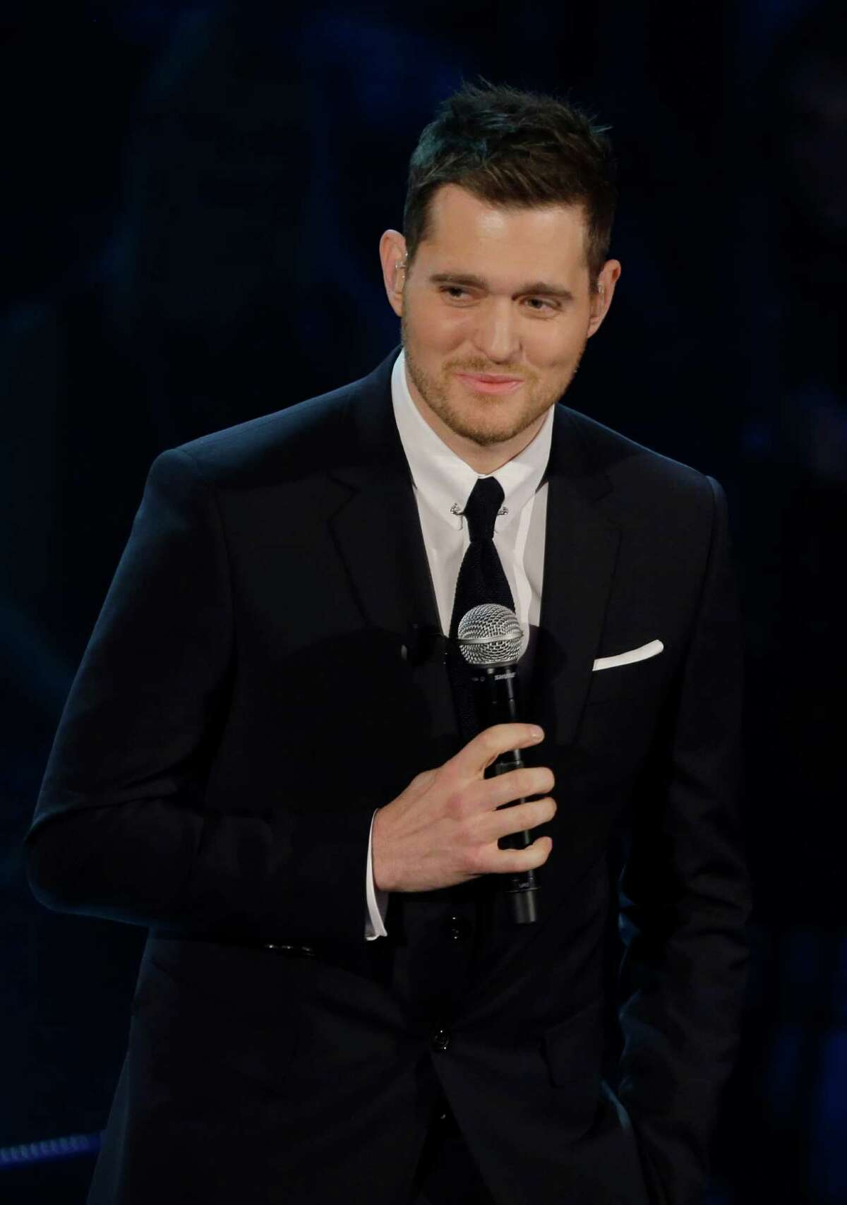"""FILE - In this Nov. 26, 2012 file photo, Canadian singer Michael Buble' performs during the Italian State RAI TV program """"Che Tempo che Fa"""", in Milan, Italy. (AP Photo/Luca Bruno, File)"""