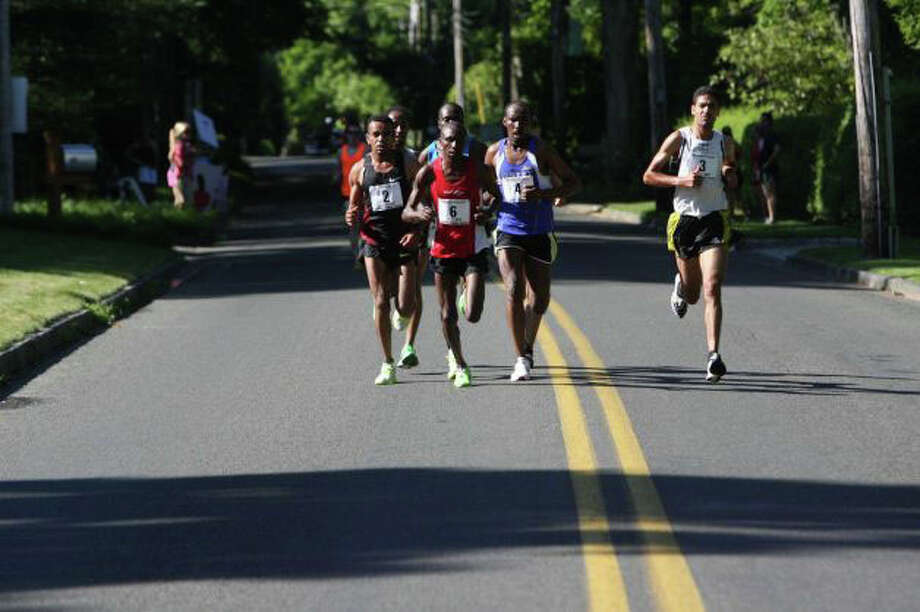 The 2013 Stratton Faxon Fairfield Half Marathon will include a three-mile section that traverses the Green's Farms section of Westport. Photo: Contributed Photo, File Photo / Westport News contributed
