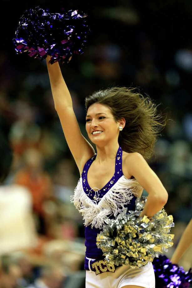 TCU Horned Frogs cheerleaders perform during the first round of the 2013 Big 12 Men's Basketball Championship at Sprint Center on March 13, 2013 in Kansas City, Missouri. Photo: Jamie Squire, Getty Images / 2013 Getty Images