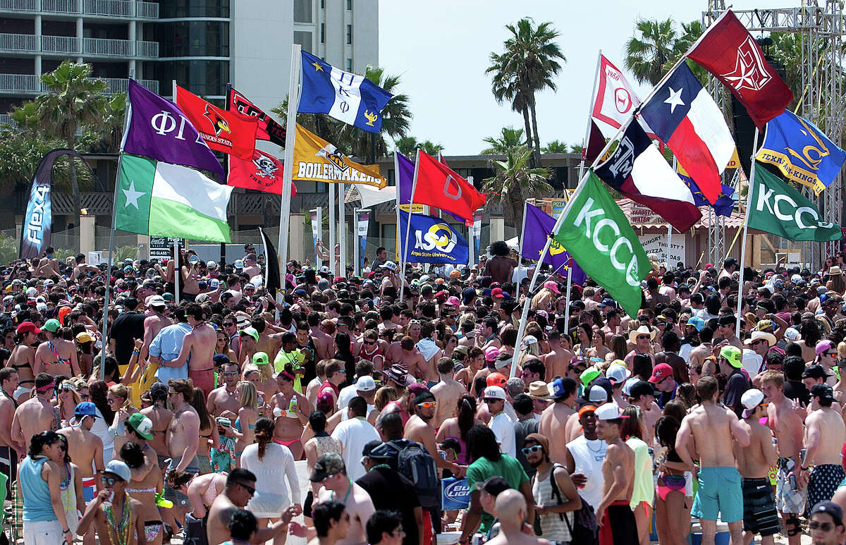 Flags of different universities and organizations were on display during spring break on Tuesday, Mar. 12, 2013 at South Padre Island, Texas. (AP Photo/The Brownsville Herald, Paul Chouy)