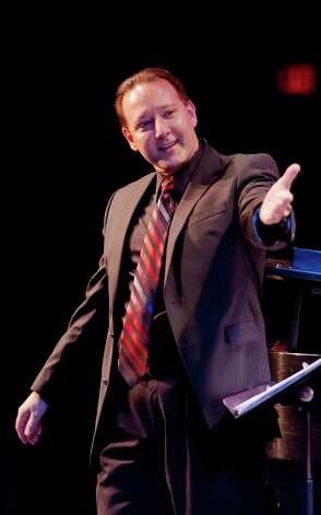 "Galen Tate, assistant director of Sacred Heart University's choral ensembles, will be one of the conductors of ""How Can I Keep From Singing?"" concert Saturday, March 23, on campus in Fairfield. Photo: Contributed Photo / Connecticut Post Contributed"