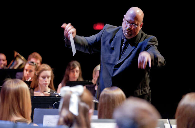 The Sacred Heart University Concert Band will perform at a free memoriam concert Sunday, March 24, led by Keith Johnston, director of SHU bands. Photo: Contributed Photo
