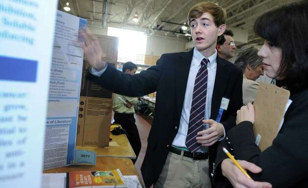 Jeffrey Sload, a senior at Darien High School, talks with judge Christina Zito, a professor in the Department of Biology and Environmental Sciences at the University of New Haven, during judging for the Connecticut Science & Engineering Fair Thursday, Mar. 14, 2013 at Quinnipiac University in Hamden, Conn. Photo: Autumn Driscoll / Connecticut Post
