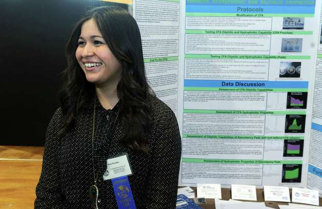 Ana Pontes, of Bridgeport, a senior at Bridgeport Regional Aquaculture School, stands by her project during judging for the Connecticut Science & Engineering Fair Thursday, Mar. 14, 2013 at Quinnipiac University in Hamden, Conn. Photo: Autumn Driscoll / Connecticut Post