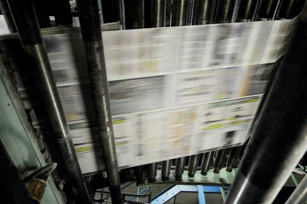 The Times Union's Sunday paper is printed on a 1970's Goss Headliner press early Sunday morning, Feb. 17, 2013, at the Times Union in Colonie, N.Y. (Will Waldron/Times Union) Photo: Will Waldron