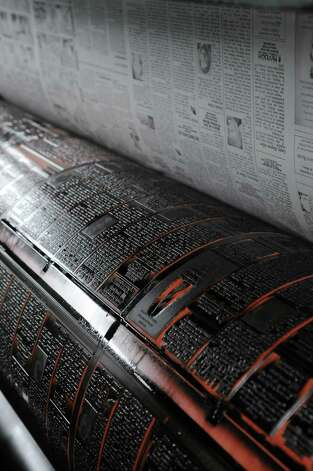 A view of the press plates attached on the rollers of the Goss letter press in the pressroom at the Times Union in Colonie, NY on Monday, March 31, 2008. (Paul Buckowski/Times Union) Photo: Paul Buckowski / Albany Times Union