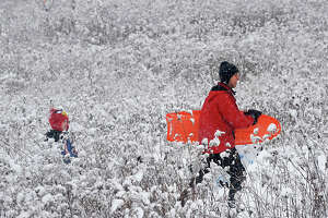 Mason Smolen, 6, of Guilderland starts the walk up the hill with his father Tom Smolen after sledding into the weeds at the Tawasentha Park Winter Recreation Area during the Capital Region's first snow storm of the season on Thursday Dec. 27, 2012 in Guilderland, N.Y. (Lori Van Buren / Times Union)