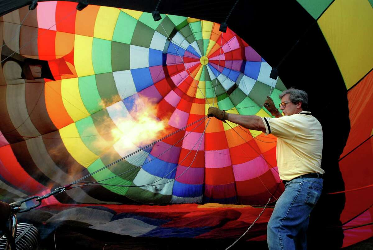 Times Union staff photo by Cindy Schultz -- Local crew member Gary Liebl (cq) of Lake Luzerne holds hot air balloon