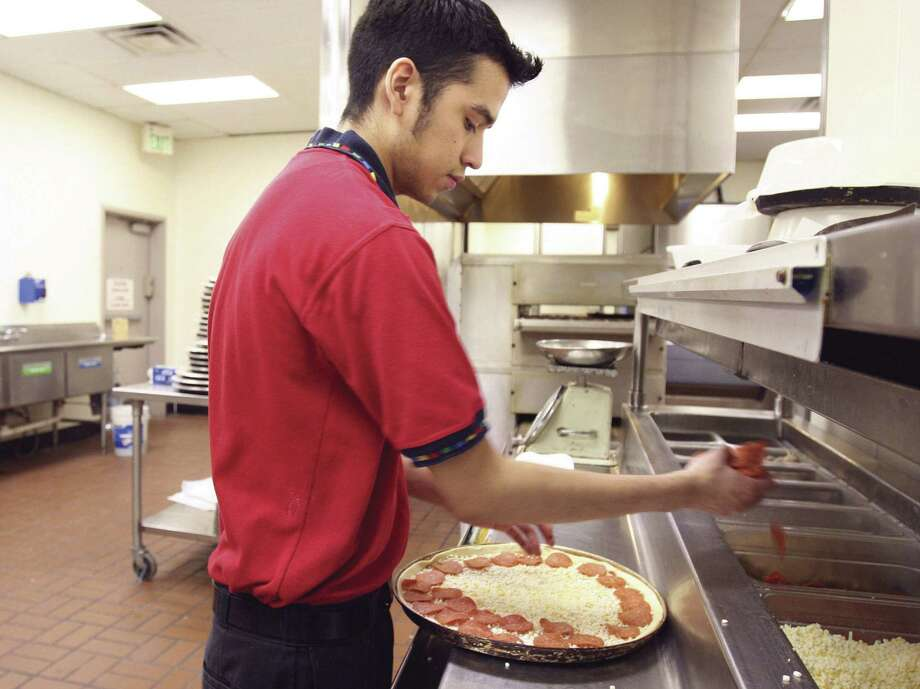 Fewer Texas workers are being paid the minimum wage, but the state still has a greater percentage of minimum-wage workers than most of the nation. Photo: File Photo, San Antonio Express-News